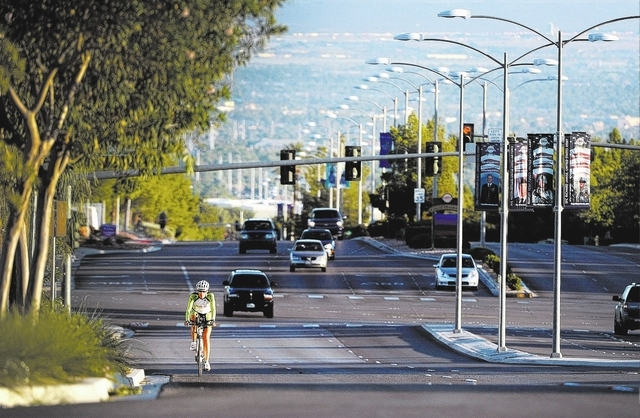 Henderson resident Michelle White-Sukala rides up Green Valley Parkway during a morning workout on Saturday, Sept. 28, 2013.  White-Sukala, a marathoner and triathlete was diagnosed with breast ca ...