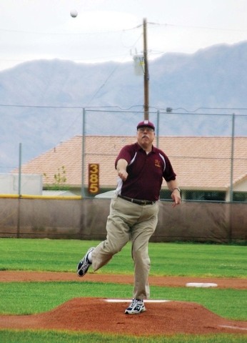 Rod Poteete throws out the first pitch before a Sunset Region Class 4-A Southwest Division between Pahrump Valley High School and Las Vegas Desert Oasis in spring 2009. Poteete was Pahrump's head  ...