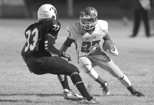 Green Valley's Markus Varner looks to get past Canyon Springs' Christian Minor during a game at Canyon Springs High School in North Las Vegas on Thursday, Oct. 24, 2013. (Chase Stevens/Las Vegas R ...