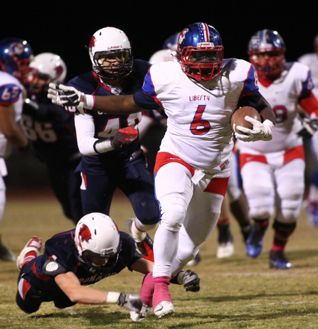 Liberty's Calvin Tubbs (6) drives past Coronado during a football game at Coronado High School in Henderson on Friday, Oct. 4, 2013. (Chase Stevens/Las Vegas Review-Journal)