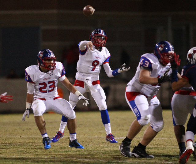 Liberty's Tyler Newman (9) makes a pass while playing against Coronado during a football game at Coronado High School in Henderson on Friday, Oct. 4, 2013. (Chase Stevens/Las Vegas Review-Journal)