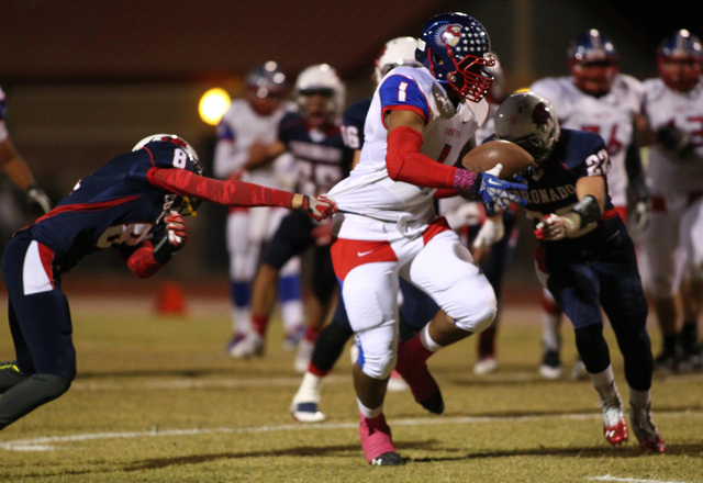 Liberty's Stephon Sowers (1) drives past Coronado during a football game at Coronado High School in Henderson on Friday, Oct. 4, 2013. (Chase Stevens/Las Vegas Review-Journal)