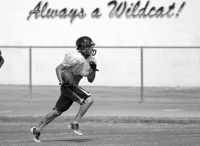Las Vegas High School running back Andrew Moreland runs with the ball during practice at the school in Las Vegas Tuesday, Aug. 27, 2013. (John Locher/Las Vegas Review-Journal)
