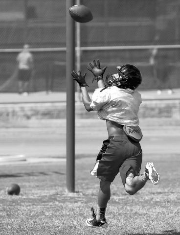 Las Vegas High School running back Andrew Moreland catches a pass ball during practice at the school in Las Vegas Tuesday, Aug. 27, 2013. (John Locher/Las Vegas Review-Journal)