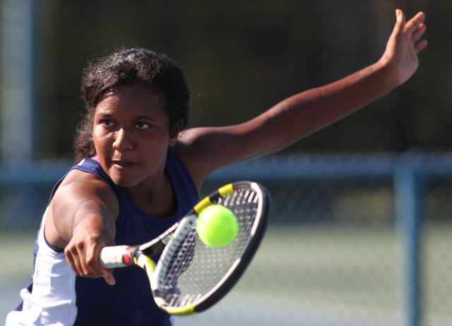 Coronado's Paris Reese looks to hit the ball against Green Valley's Josie Legarza during the Division I Sunrise Region final at the Darling Tennis Center in Las Vegas on Saturday, Oct. 12, 2013. ( ...