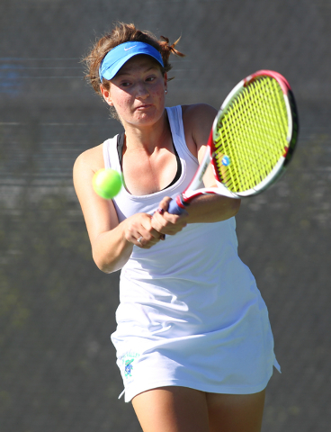 Green Valley's Josie Legarza looks to hit the ball against Coronado's Paris Reese during the Division I Sunrise Region final at the Darling Tennis Center in Las Vegas on Saturday, Oct. 12, 2013. ( ...