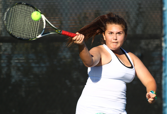 Green Valley's Megan Madrid hits the ball against Coronado's Lauren Coons during the Division I Sunrise Region final at the Darling Tennis Center in Las Vegas on Saturday, Oct. 12, 2013. (Chase St ...