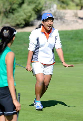 Bishop Gorman's Katie DeJesus reacts after making a birdie on the third hole during the Sunset Region girls golf tournament at Siena Golf Club on Tuesday, Oct. 15, 2013.  (David Becker/Las Vegas R ...