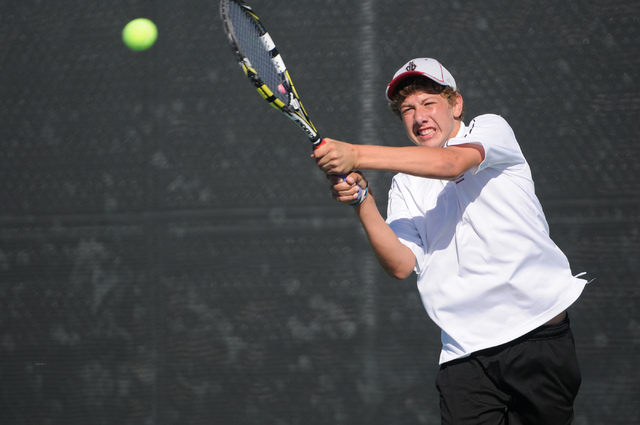 Desert Oasis's Ben Gajardo hits the ball back to his opponent Dylan Leavitt from Bishop Gorman during the tennis singles Sunset Region Championships at Bishop Gorman High School in Las Vegas, Nev. ...