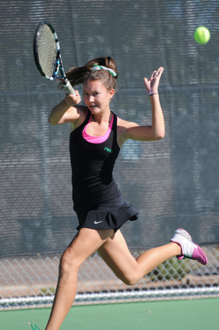 Palo Verde's Annie Walker, hits the ball back to her opponent Chelsea Crovetti from Bishop Gorman during the tennis singles Sunset Region Championships at Bishop Gorman High School in Las Vegas, N ...