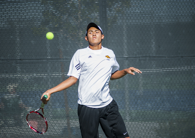 Clark's Miko Pasimio keeps his eye on the ball. (Martin S. Fuentes/Las Vegas Review-Journal)