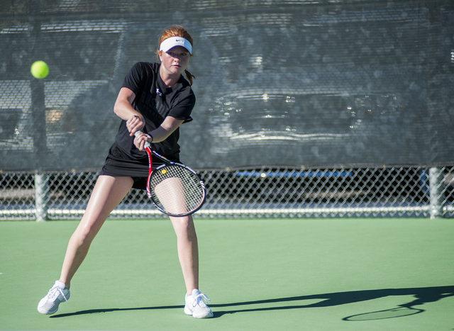 Faith Lutheran High School tennis player, Madison Foley, freshman, returns a volley during the NIAA Division 1A State Tournament, girl's championship match, held at the Bishop Gorman tennis courts ...