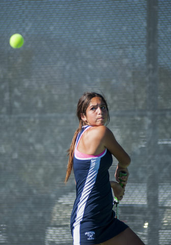 The Meadows High School tennis player, Abbigail Klein, freshman, returns a volley during the NIAA Division 1A State Tournament, girl's championship match, held at the Bishop Gorman tennis courts,  ...