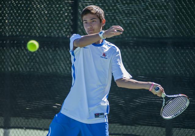 BIshop Gorman High School tennis player, Dylan Levitt, freshman, returns a volley during the NIAA Division 1 State Tournament, boy's championship match, held at the Bishop Gorman tennis courts, in ...