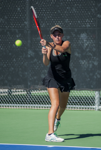 Palo Verde High School tennis player, Chloe Henderson, sophmore, returns a volley during the NIAA Division 1 State Tournament, girl's double championship match, held at the Bishop Gorman tennis co ...