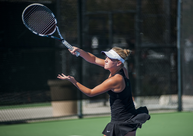 Palo Verde High School tennis player, Sophie Henderson, freshman, returns a volley during the NIAA Division 1 State Tournament, girl's double championship match, held at the Bishop Gorman tennis c ...