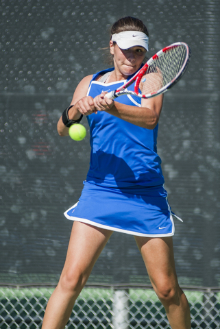 Bishop Gorman High School tennis player, Zoe Lier, freshman, returns a volley during the NIAA Division 1 State Tournament, girl's double championship match, held at the Bishop Gorman tennis courts ...