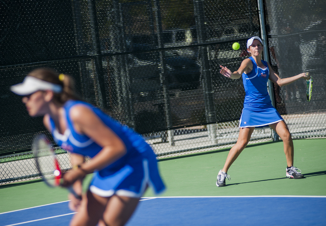 BIshop Gorman High School tennis player, Julia McDonald, senior, returns a volley during the NIAA Division 1 State Tournament, girl's double championship match, held at the Bishop Gorman tennis co ...