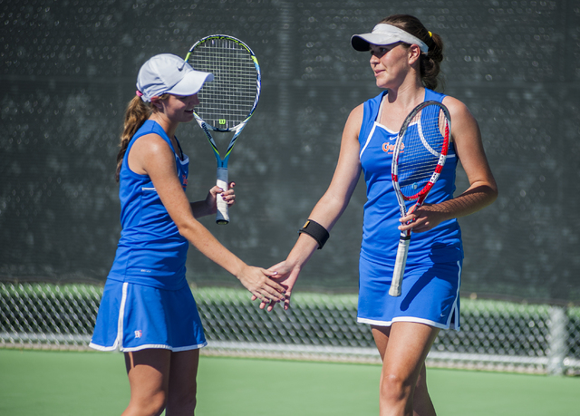 Bishop Gorman High School tennis players, from left,  Julia McDonald, senior, and Zoe Lier, freshman, high fives each other, during the NIAA Division 1 State Tournament, girl's double championship ...