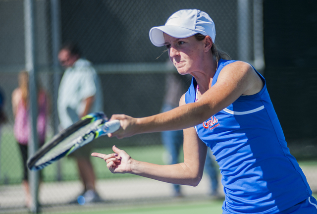 Bishop Gorman High School tennis player, Julia McDonald, senior, returns a volley, during the NIAA Division 1 State Tournament, girl's double championship match, held at the Bishop Gorman tennis c ...