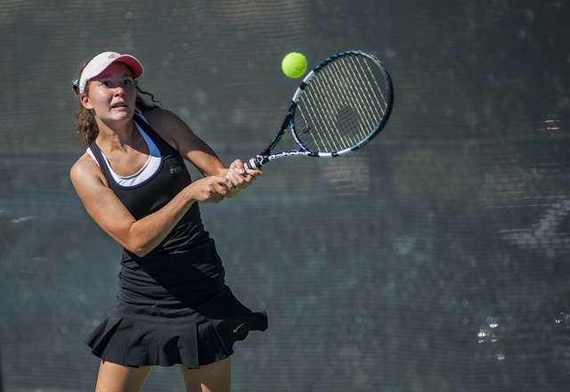 Palo Verde High School tennis player, Annie Walker, freshman, returns a volley, during the NIAA Division 1 State Tournament, girl's championship match, held at the Bishop Gorman tennis courts, in  ...
