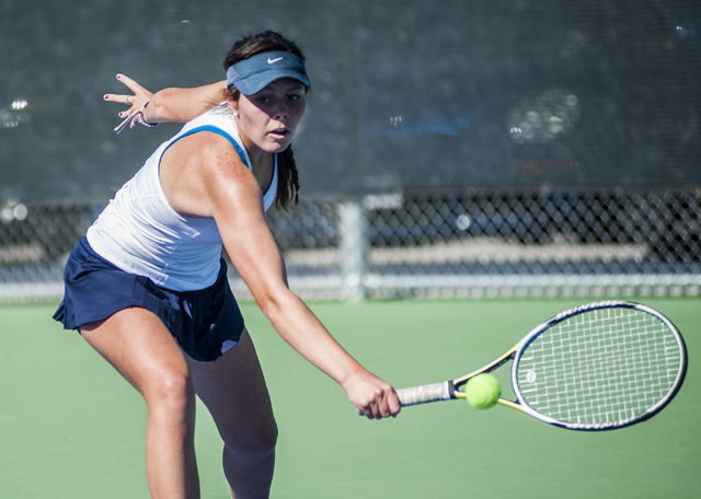 Centennial High School tennis player, McKay Novak, senior, returns a volley, during the NIAA Division 1 State Tournament, girl's championship match, held at the Bishop Gorman tennis courts, in Las ...