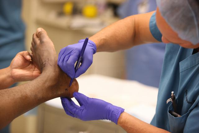 Dr. Troy Watson prepares Las Vegas boxer Sharif Bogere for a platelet-rich plasma (PRP) injection operation with at the Desert Orthopedic Center, 2800 E. Desert Inn in Las Vegas on Monday, Aug. 26 ...