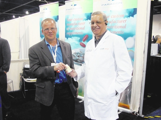 COURTESY HANDOUT PHOTO PV-TUSHMD-AUG03 Paragon Labs CEO Jay Kaufman, left, talks with Dr. Joseph Thornton, MD, board-certified colorectal surgeon, during the Natural Products Association MarketPla ...