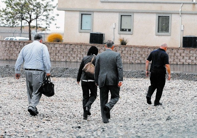 Nye County Sheriff's Office Assistant Sheriff Rick Marshall along with two FBI Agents and DA Brian Kunzi head towards the Assessor's office Wednesday. (Horace Langford Jr. / Pahrump Valley Times)