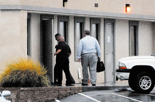 Nye County Sheriff's Office assistant Sheriff Rick Marshall with FBI agent and DA Brian Kunzi entering the Assessor's office Wednesday. (Horace Langford Jr. / Pahrump Valley Times)