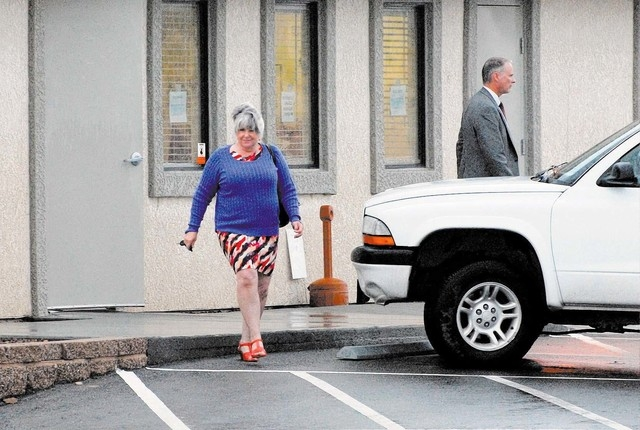 Nye County Assessor Shirley Matson leaves her office with the FBI in tow Wednesday. (Horace Langford Jr. / Pahrump Valley Times)