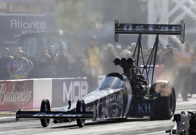 NHRA Top Fuel driver Shawn Langdon pilots his dragster off the starting line during the second round of the NHRA Toyota Nationals at the Las Vegas Motor Speedway on Sunday. (Josh Holmberg/Las Vega ...
