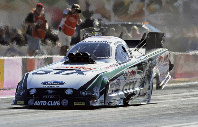 NHRA Funny Car driver John Force pilots his car off the starting line during the second round of the NHRA Toyota  Nationals at the Las Vegas Motor Speedway on Sunday.(Josh Holmberg/Las Vegas Revie ...