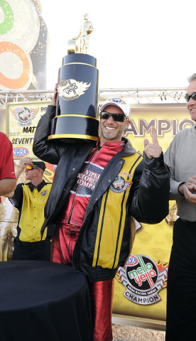 NHRA Pro Stock Motorcycle rider Matt Smith hoists the championship trophy after winning at the NHRA Toyota Nationals Sunday at the Las Vegas Motor Speedway. (Josh Holmberg/Las Vegas Review-Journal)
