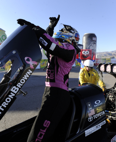 NHRA Top Fuel dragster driver Antron Brown celebrates after winning the NHRA Top Fuel finals Sunday at the Las Vegas Motor Speedway. (Josh Holmberg/Las Vegas Review-Journal)