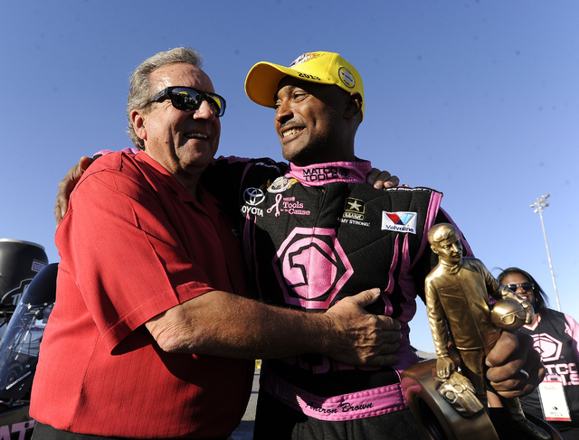 NHRA Top Fuel dragster driver Antron Brown, right, celebrates with team owner Don Schumacher after winning the NHRA Top Fuel finals at the Las Vegas Motor Speedway on Sunday. (Josh Holmberg/Las Ve ...