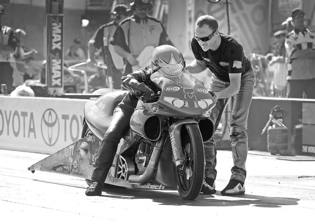 Pro stock motorcycle racer Matt Smith, right, speaks with his wife, Angie Smith, before her qualifying heat at The Strip at the Las Vegas Motor Speedway on Friday, Oct. 25, 2013. (David Becker/Las ...
