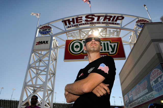 Pro stock motorcycle racer Matt Smith watches the action before his afternoon qualifying heat at The Strip at the Las Vegas Motor Speedway on Friday, Oct. 25, 2013. (David Becker/Las Vegas Review- ...