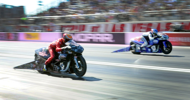 Matt Smith, left, races against Hector Arana Jr. in an afternoon pro stock motorcycle class qualifying heat at The Strip at the Las Vegas Motor Speedway on Friday, Oct. 25, 2013. Smith beat Arana  ...