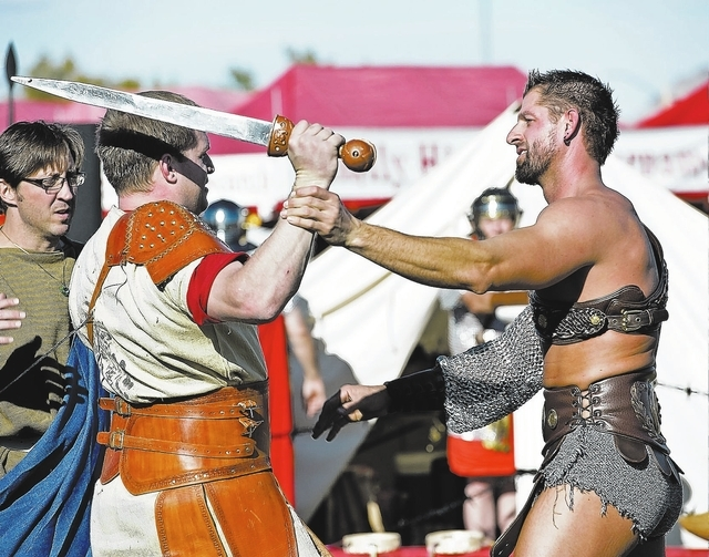 JERRY HENKEL/LAS VEGAS REVIEW-JOURNAL Eric Braun, with sword, and Marty Windham, right, run through a rehearsal of their gladiator show in the Gladius Coliseum at the Age of Chivalry Renaissance F ...