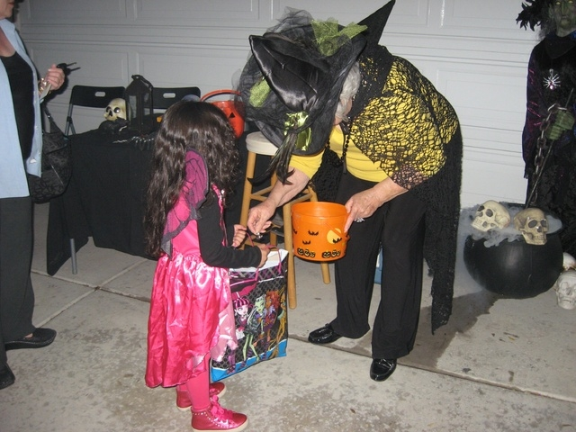 Children receive small candies on the sidewalk near Rictor Riolo's home but have to brave the scary display to get to the large candy at the door. (Special to View)