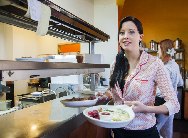 Shannon Miller, server, from Rise & Shine, a Steak and Egg Place, serves up an omelet and french toast, to customers, at their restaurant located at 10690 Southern Highlands Parkway 89141, in Las  ...