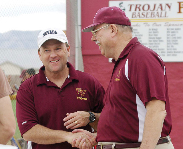 Rod Poteete, right, shakes hands with Mike Floyd. The two are members of the Pahrump Valley High School Athletics Hall of Fame. (Horace Langford Jr./Pahrump Valley Times)
