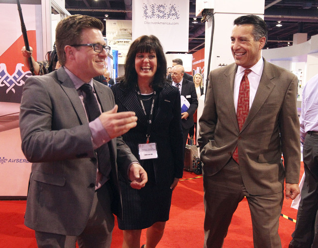 Nigel Mayes, vice president for UBM Aviation Routes, Ltd, left, talks with Rosemary Vassiliadis, Clark County Deputy Director of Aviation and Nevada Gov. Brian Sandoval at the World Routes Confere ...