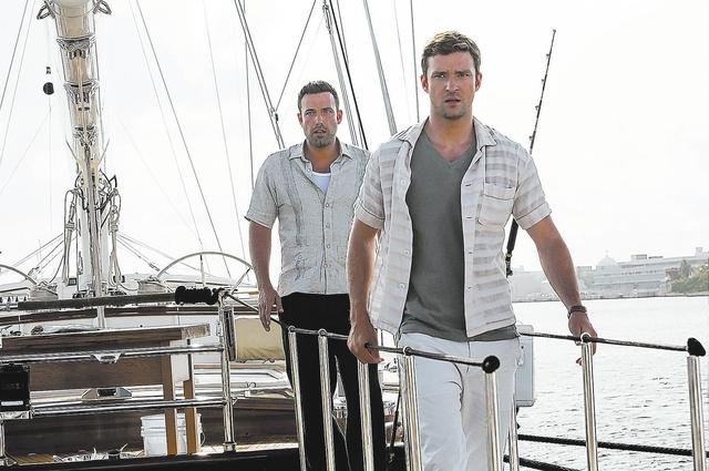 RUNNER, RUNNER  Richie Furst (Justin Timberlake) and Ivan Block (Ben Affleck) form an uneasy alliance.  Ph: Scott Garfield  Copyright © 2013 Twentieth Century Fox Film Corporation. All rights res ...