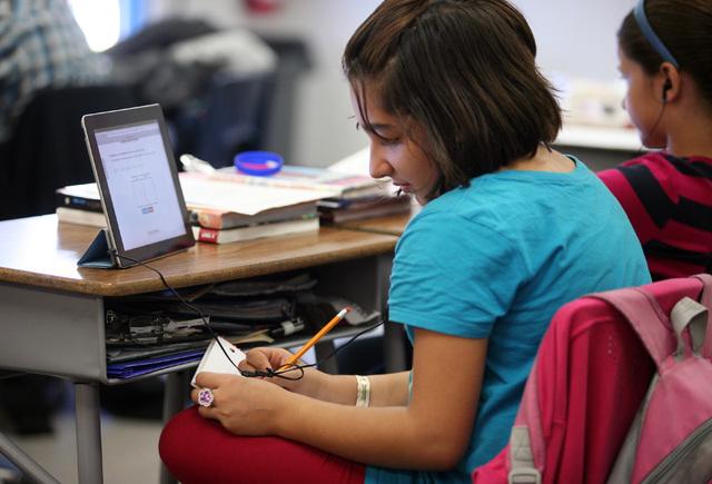 Sara Rajabi works with a web-based phonic program called Lexia on an iPad in Stephanie Larson's 5th grade class at Hancock Elementary School Friday, Oct. 18, 2013, in Las Vegas. Hancock Elementary ...