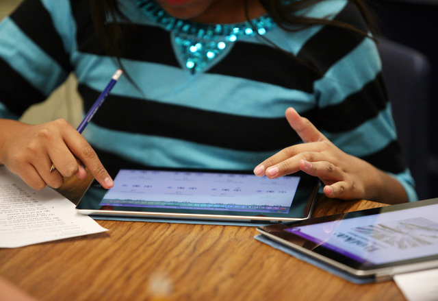 A 5th grade student works on an iPad during a reading class at Hancock Elementary School Friday, Oct. 18, 2013, in Las Vegas. Hancock Elementary School is a Positive Behavior Intervention School,  ...