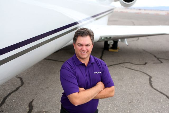 Set Jet CEO Tom Smith stands next to a company CRJ 200 jet at Signature Flight Station Thursday, Oct. 10, 2013, in Las Vegas. Set Jet, which is based out of Scottsdale, Ariz., is bringing its priv ...