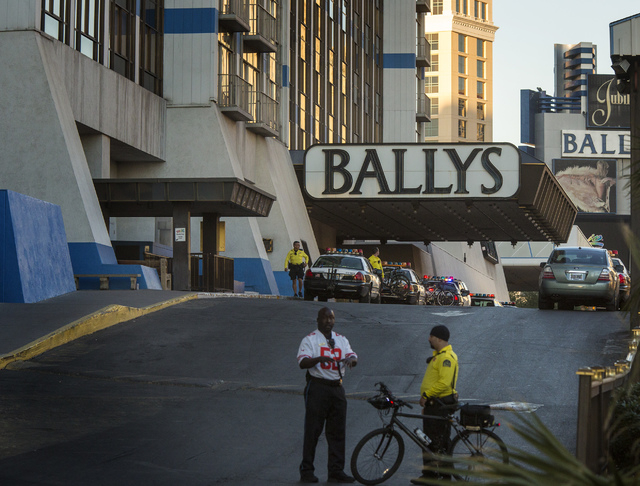 Security personnel stand at the Flamingo Road entrance to Bally's Las Vegas, 3645 Las Vegas Boulevard South, on Monday. One person was killed and two others were injured after a gunman opened fire ...