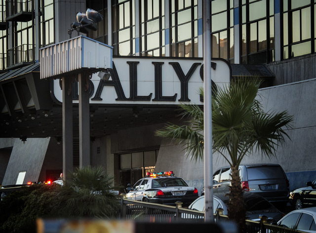 Police vehicles are seen Monday at the Flamingo Road entrance to Bally's Las Vegas. One person was killed and two others were injured after a gunman opened fire inside the hotel-casino on the Las  ...